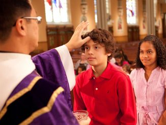 receiving ashes on Ash Wednesday - image © Loyola Press. All rights reserved.