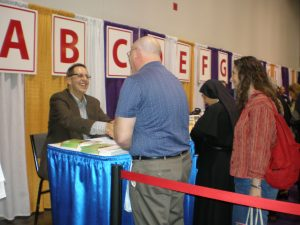 This is the book signing...here I'm greeting Deacon Richard Kulleck, who with his wife Mary, relocated from the Chicago area to the West.