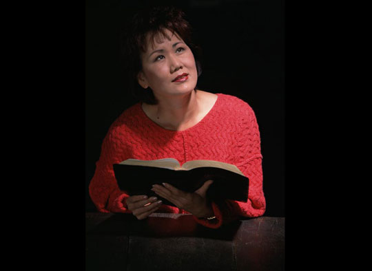 woman praying with Scripture