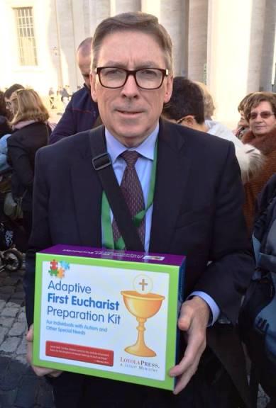 Tom McGrath with Loyola Press's Adaptive First Eucharist Preparation Kit