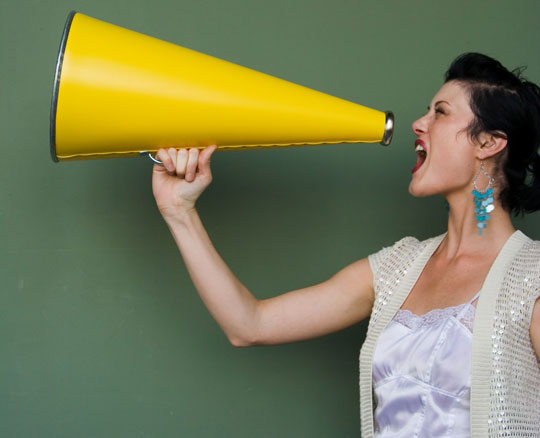 enthusiastic woman with megaphone