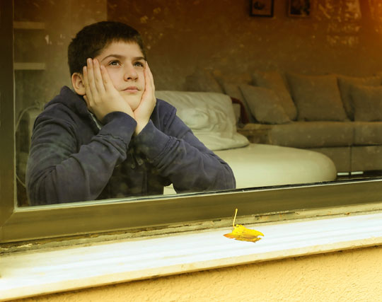 boy waiting at window