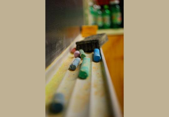 chalk and eraser on ledge