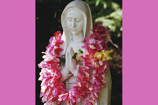 Mary statue with flowers