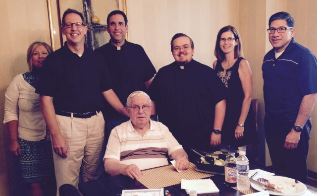 Here I am meeting the staff of Christ the King Parish: Sue Clark (Parish Secretary); Joe P.; Fr. Larry Sullivan (Pastor); Deacon Dominic Clemente (Transitional Deacon); Maura Clarke Saas (Alumni Director); Fr. Edgar Rodriguez (Associate Pastor); seated: Fr. Mike Adams (retired priest in residence).