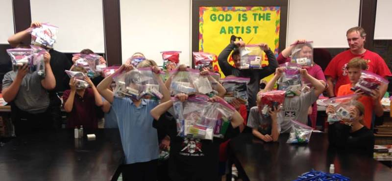 Here are the happy fifth graders showing off their completed care packages (faces hid to protect their anonymity).