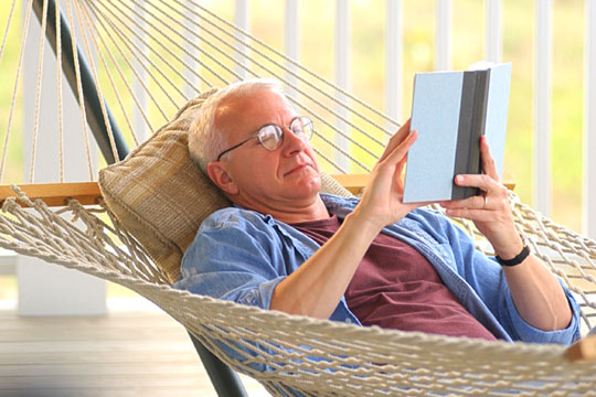 man in hammock reading