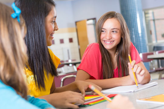 middle-school or junior high girls in classroom