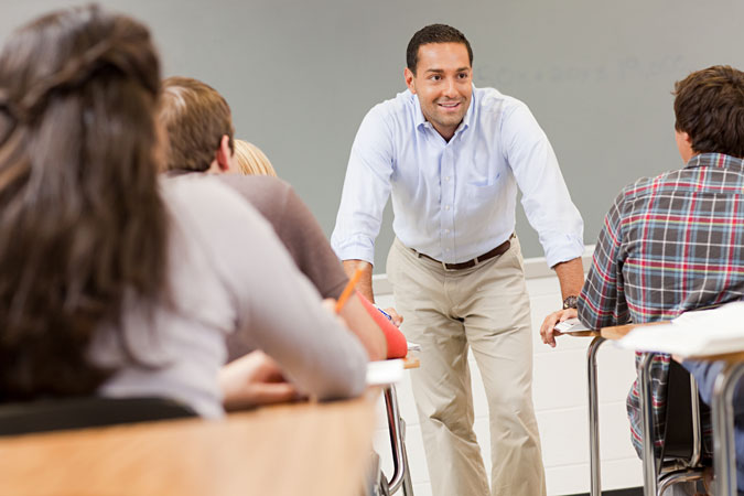 man teaching students
