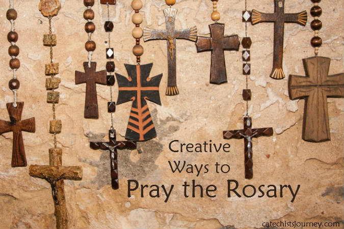 Creative Ways to Pray the Rosary - several rosaries hanging on wall