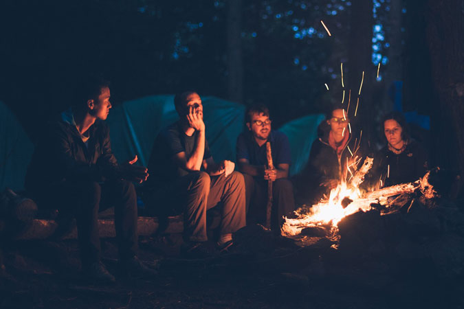young adults camping