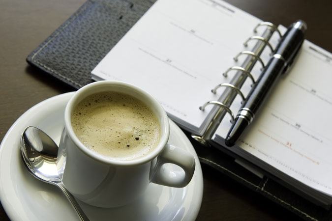 coffee and schedule - calendar book