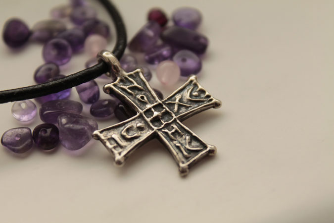 cross pendant and stones