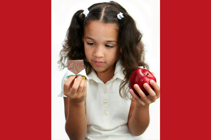 girl making choice between snack options