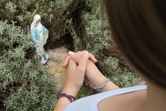 praying at Marian grotto