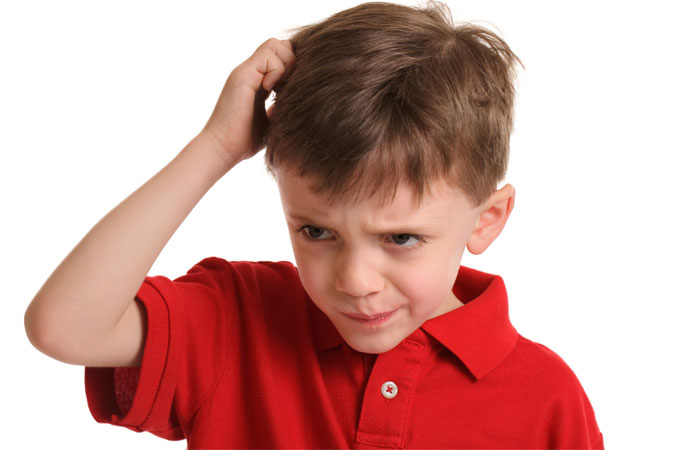 boy scratching head