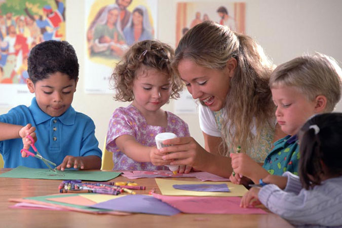 catechist with young children