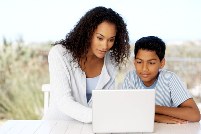 mother and son at computer