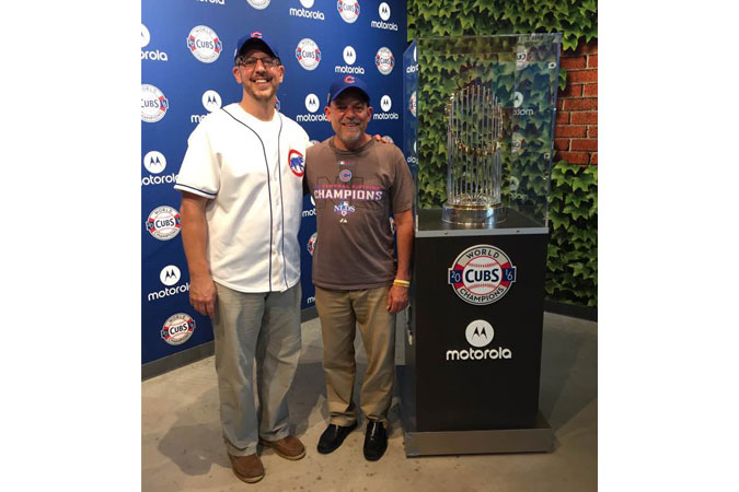Joe and Todd Williamson with the World Series trophy