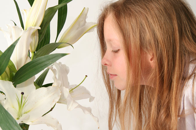 girl with Easter lilies