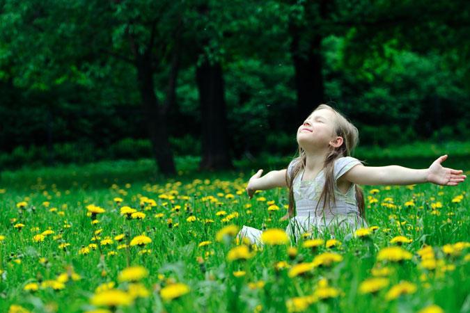 child basking in spring sun