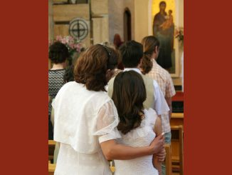 mother and daughter at Mass - in church