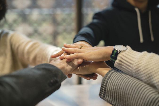 collaboration - teamwork hands