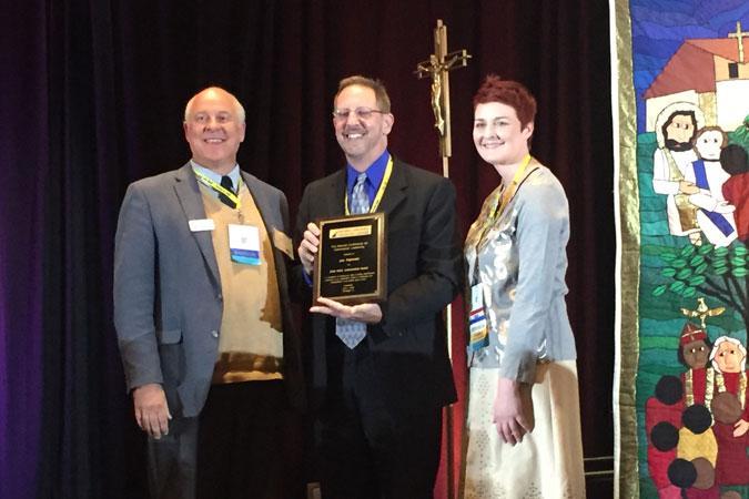 Joe Paprocki accepting the NCCL award from NCCL Executive Director Margaret Matijasevic and President Ken Ogorek