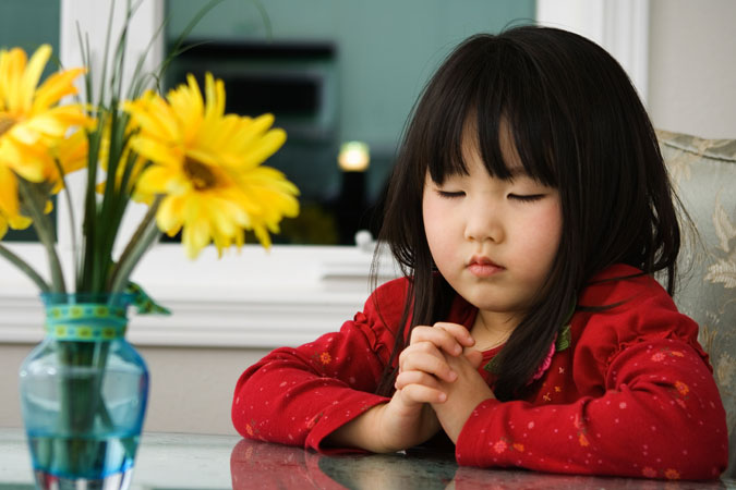 child in reflective prayer