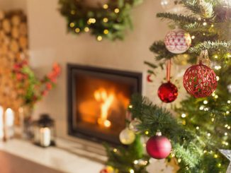 Christmas decorations by fireplace