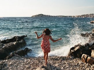 joyful young woman on beach
