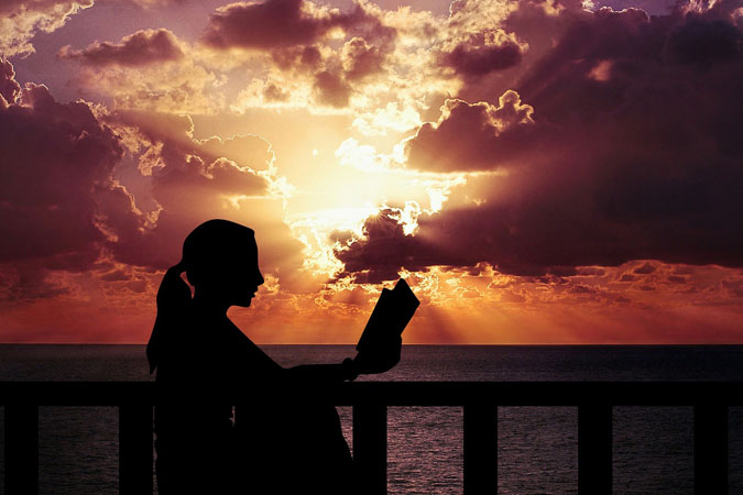 woman reading at dusk