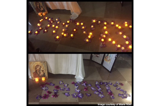 saints spelled out in flowers and tea lights