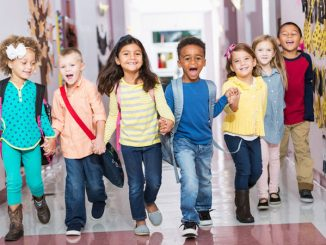 happy children in school hallway