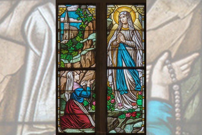 Saint Bernadette and Our Lady of Lourdes in stained glass