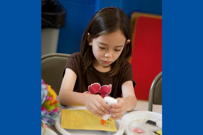 girl making craft