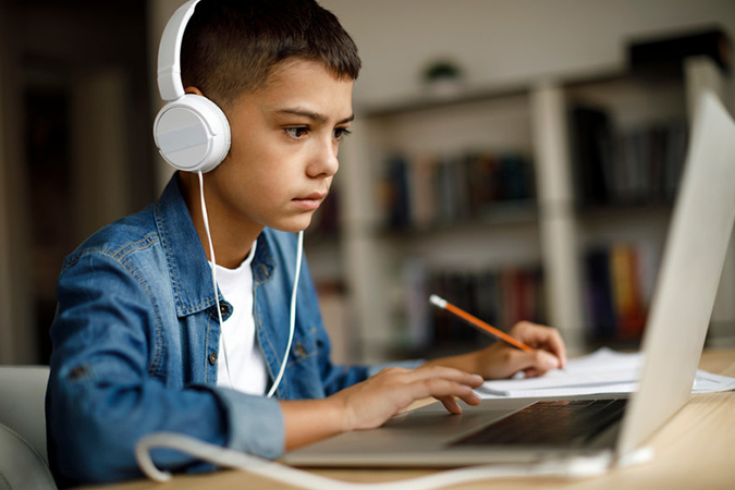boy with headphones at laptop