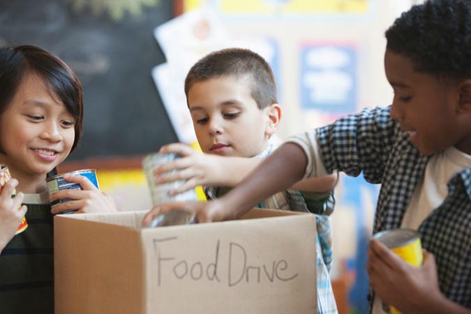 children packing food - photo by Jose Luis Pelaez Inc/DigitalVision/Getty Images